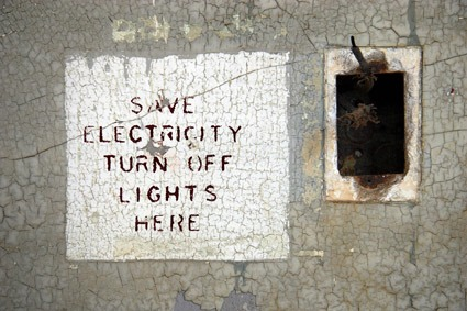 Destroyed electrical outlet and sign